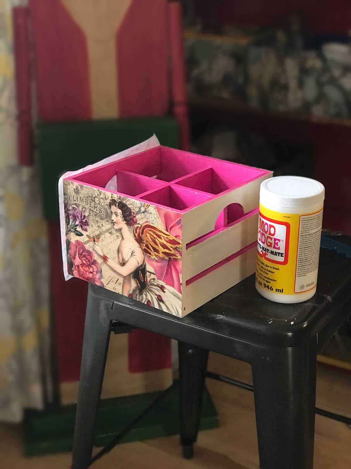 DIY Painted and Decoupaged Office Organizing Boxes :: Using Mod Podge and the Ranger Tim Holtz brayer to stick the tissue paper on the sides of the boxes.