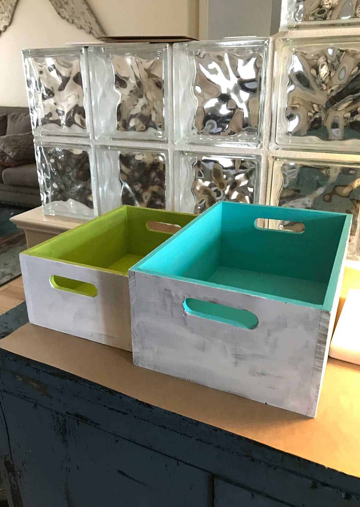 DIY Organizing Boxes - First step painting with a base of white gesso and then colorful acrylic paint inside and the bottom.