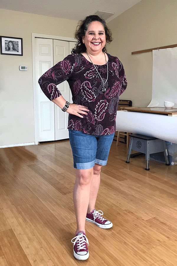 Casual Fashion Over 50 - Cute shorts outfit paired with a pretty paisley top and Converse tennis shoes. Great look for curvy, petite women who work from home and still like to dress fun and nice!