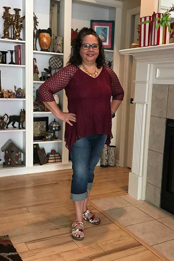 Fashion over 50 - burgundy top & jeans. How to figure out what style of clothing to wear when you are over 50.
