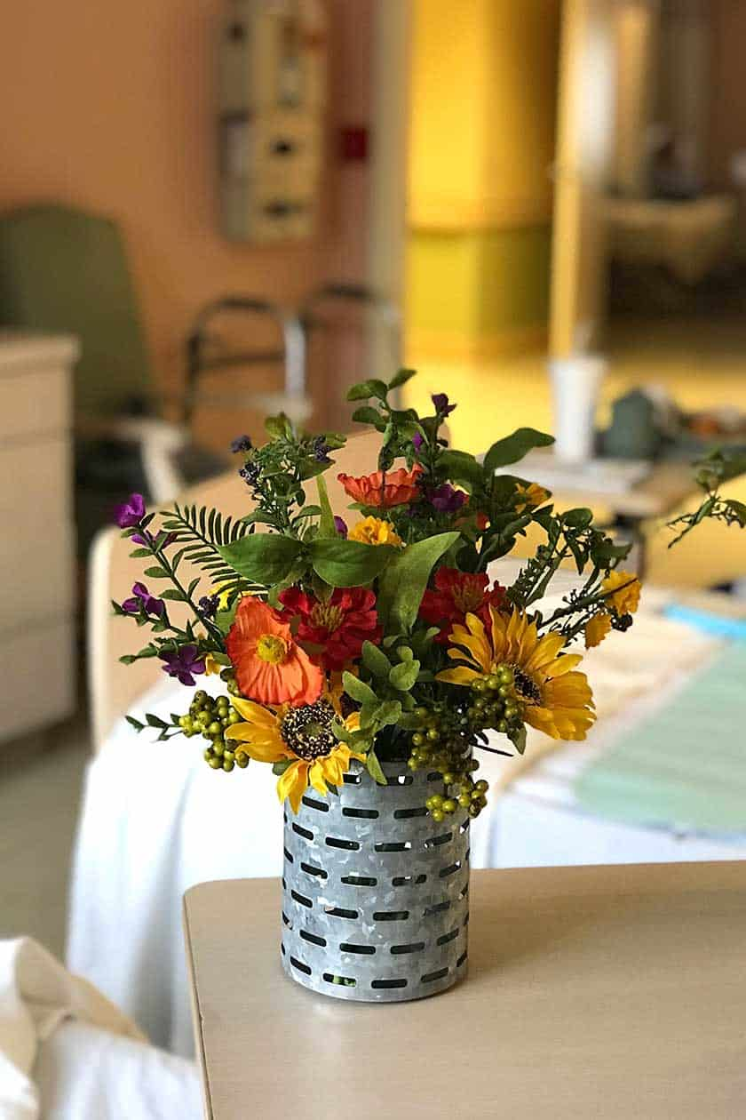 Artificial flowers, nursing home gifts for elderly women. From my 25 Fun Nursing Home Gift Ideas and Tips For Women (That Are Not Food) post. Love this beautiful flower arrangement. #nursinghome #assistedliving