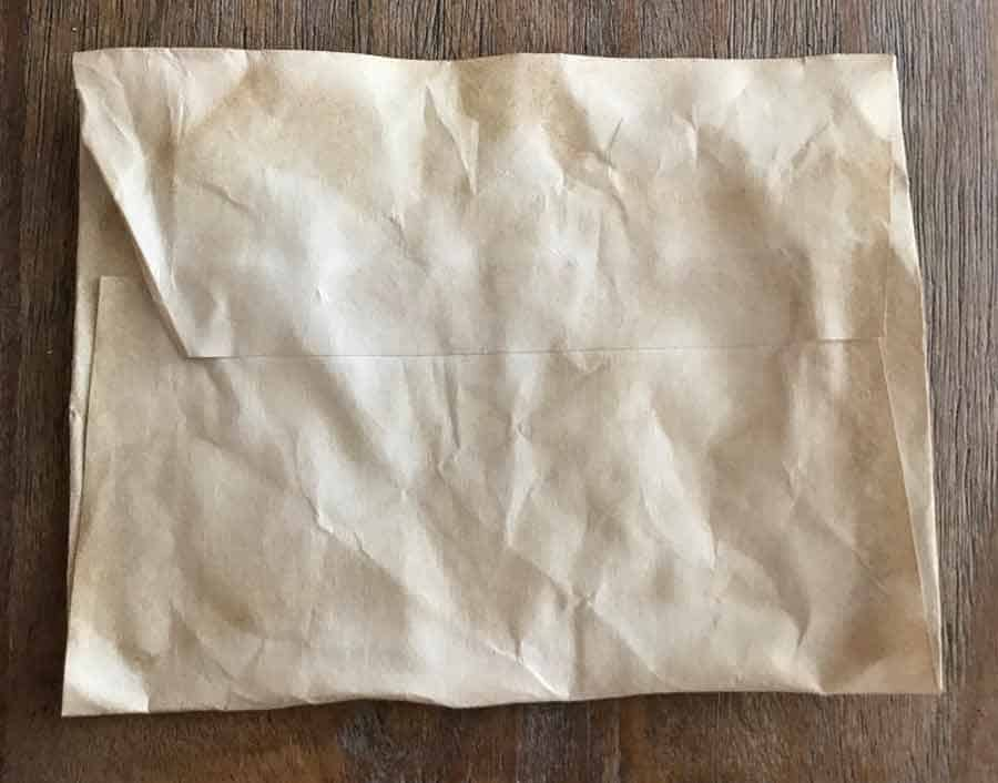 Crumpled paper envelope, coffee dyed