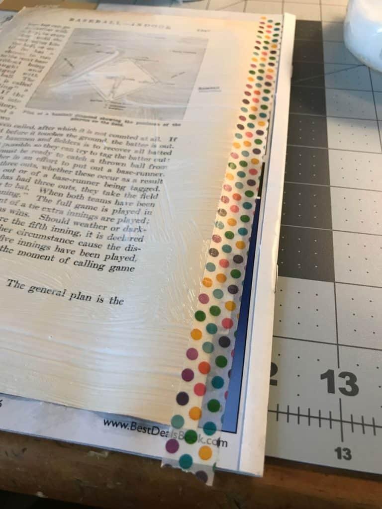 Hidden binding hinge page