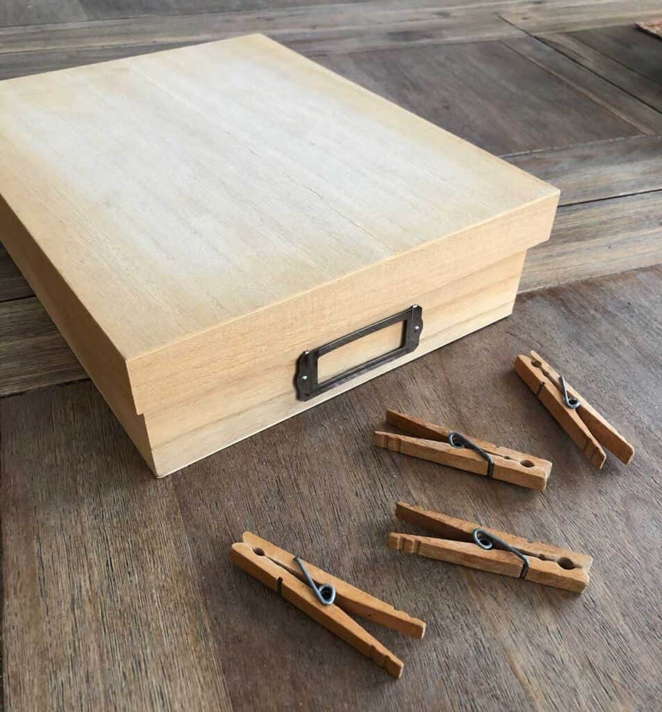 Plain wooden box for cord holder plus clothespins.
