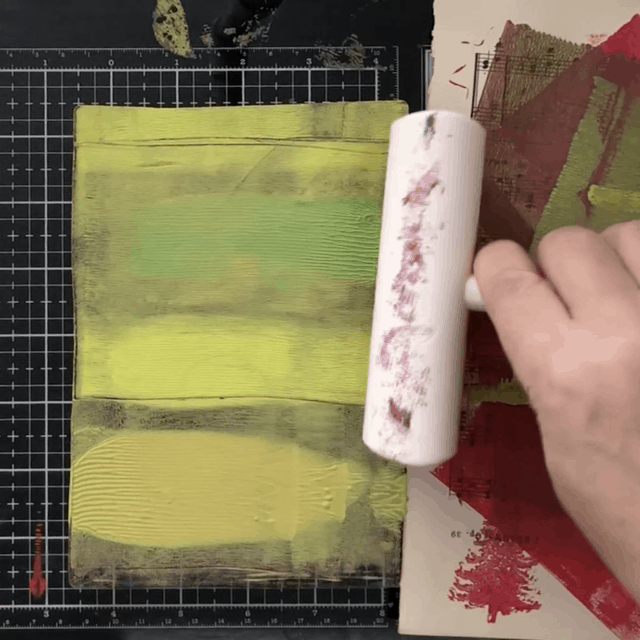 Rolling acrylic paint on gelli plate