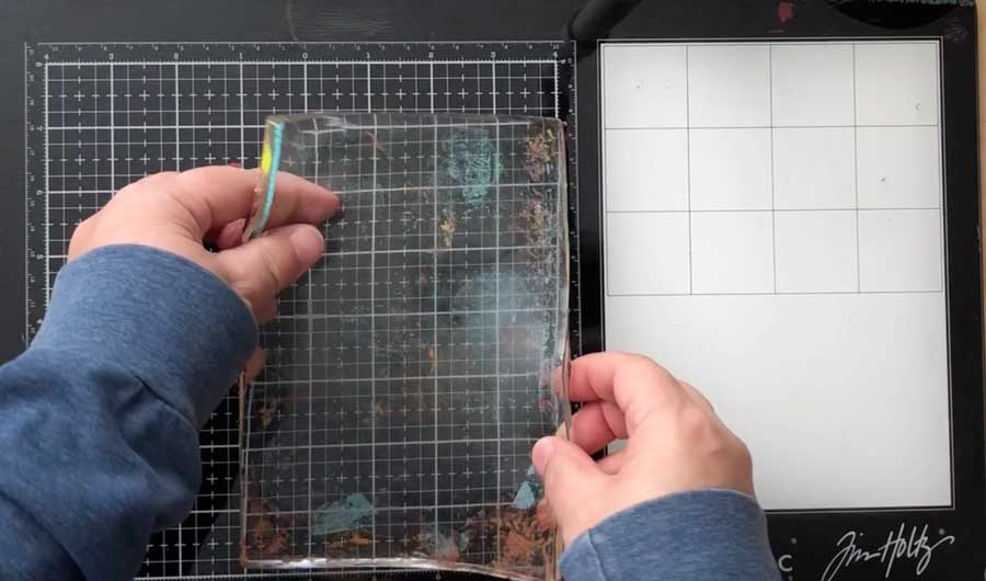 Placing gel press plate on flat surface