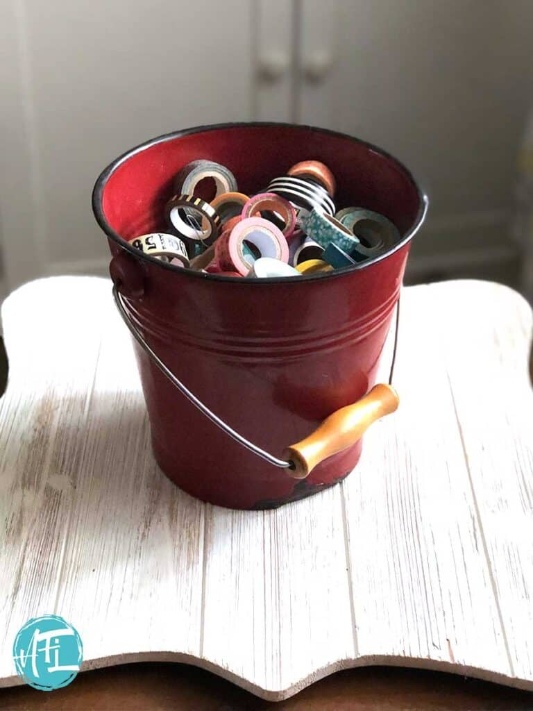 Cool old red vintage bucket full of washi tape