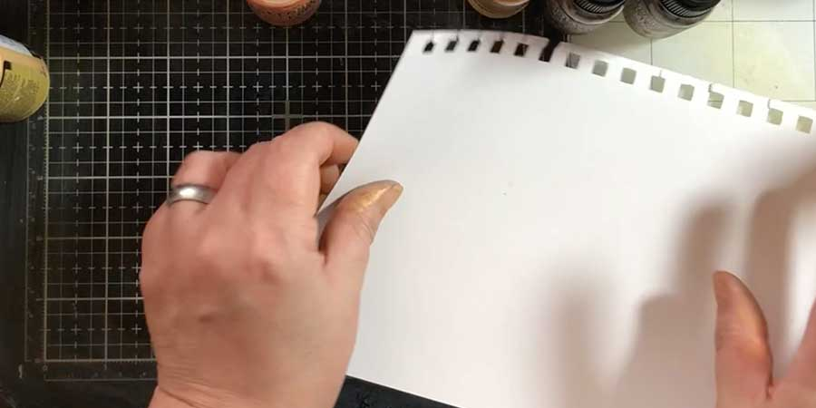 Smoosh your paper into the metallic paint (if you want it to spread more you can spray your paper with water too)