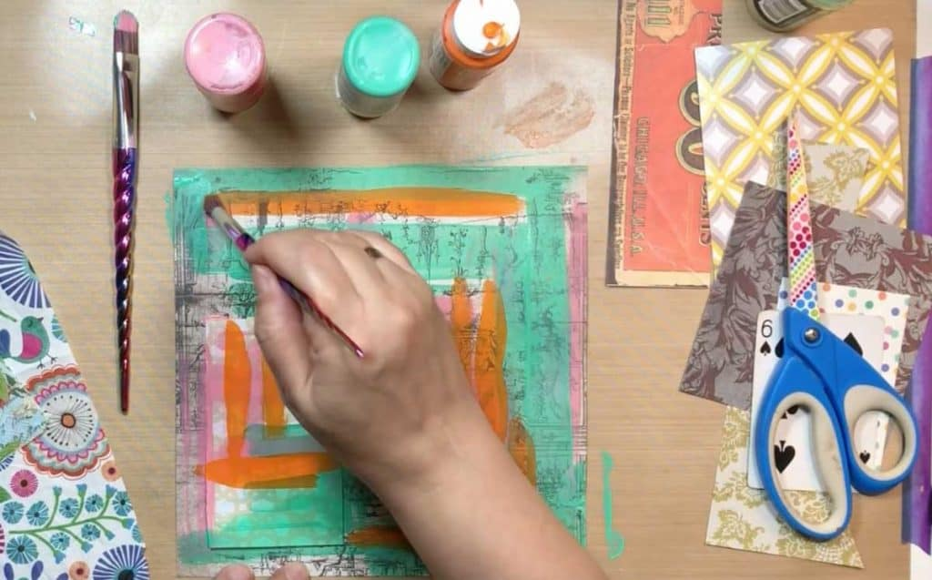 Paint some color marks on your scrapbook paper